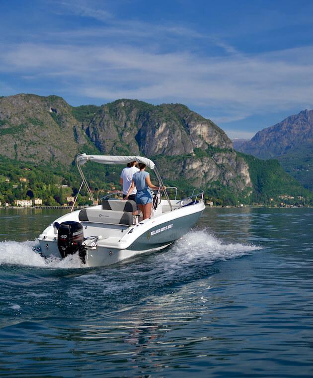 Couple driving a boat in Bellagio Lake Como