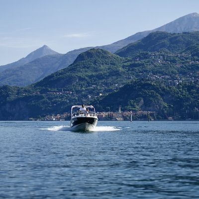 Surfing on a boat in front of Varenna